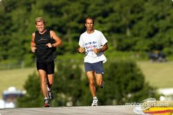 Tom Kristensen and Emanuele Pirro jogging on the track