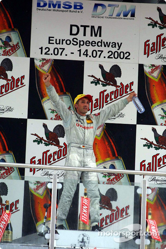The podium: race winner Bernd Schneider