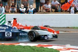Juan Pablo Montoya and Michael Schumacher battling