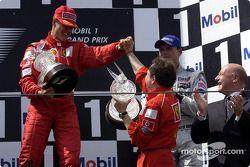 Podium: Michael Schumacher, Jean Todt, David Coulthard