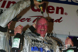 Chris Dyson soaks his father Rob with champagne during the Victory Lane celebration