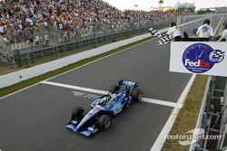 Dario Franchitti taking the checkered flag