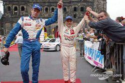 Marcus Gronholm with rally winner Sébastien Loeb