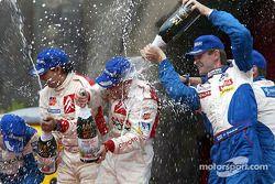The podium: rally winner Sébastien Loeb with Marcus Gronholm