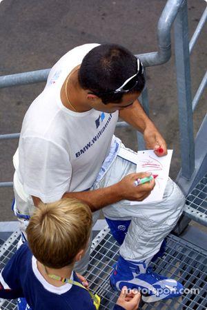 Juan Pablo Montoya signing autographs