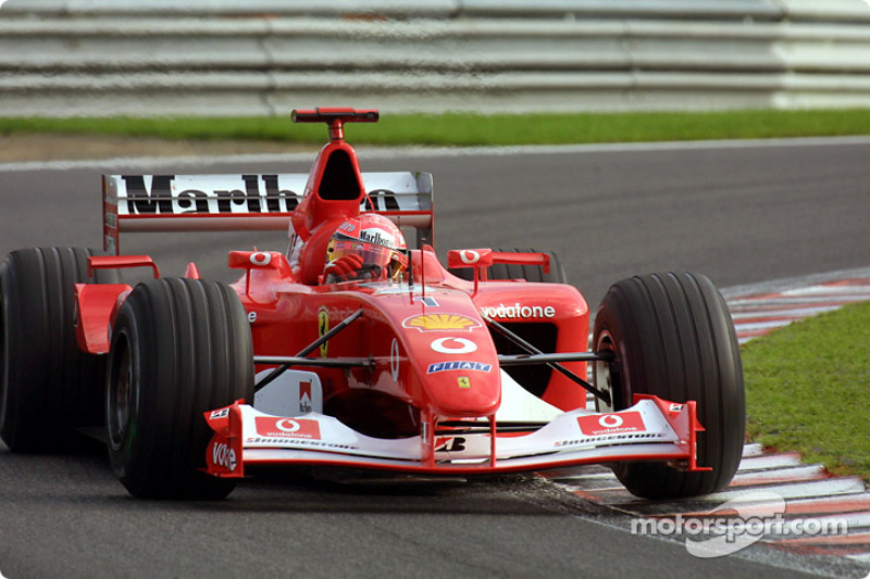 2002: Ferrari - Campeón, 11 victorias, 144 puntos, 17 GPs