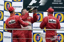 The podium: champagne for Michael Schumacher, Rubens Barrichello and Ross Brawn