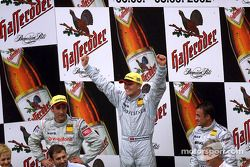 The podium: race winner Marcel Fassler with Bernd Schneider and Jean Alesi