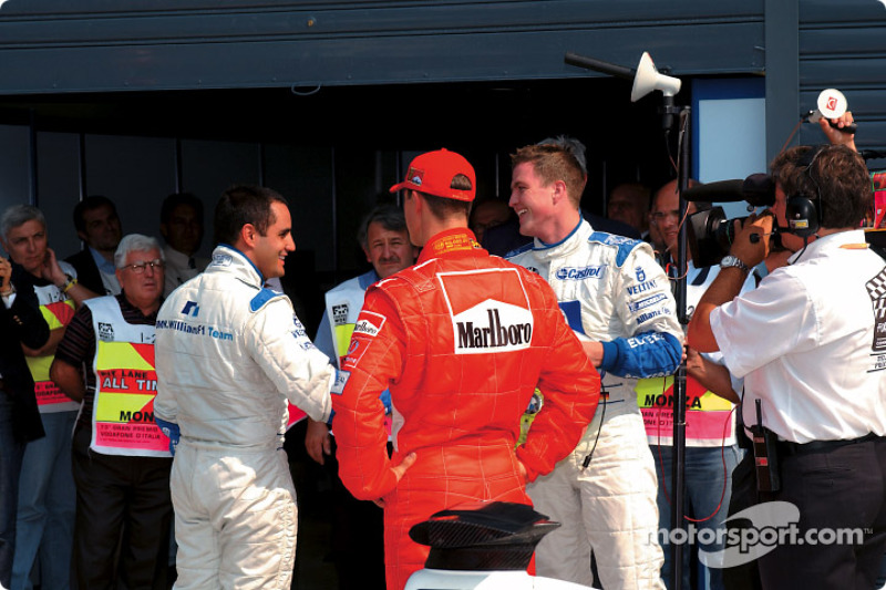 El ganador de la pole, Juan Pablo Montoya, Michael Schumacher y Ralf Schumacher
