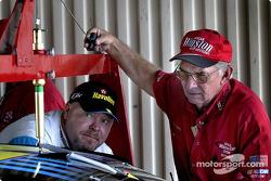Scott Wood pushes Ricky Rudds car through inspection