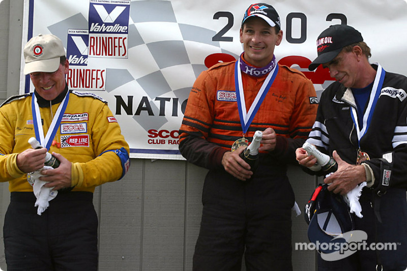 The podium: champagne for Steve Sargis, Michael Pinney and Charles Guest