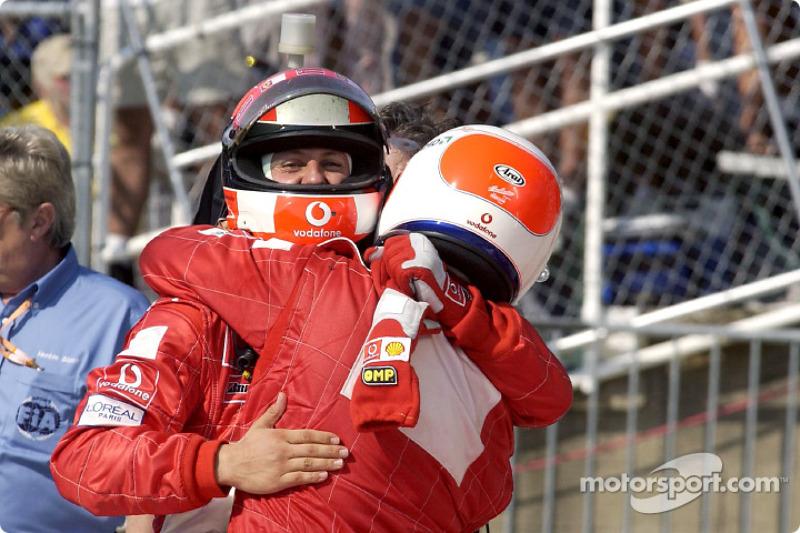 Rubens Barrichello and Michael Schumacher celebrate victory