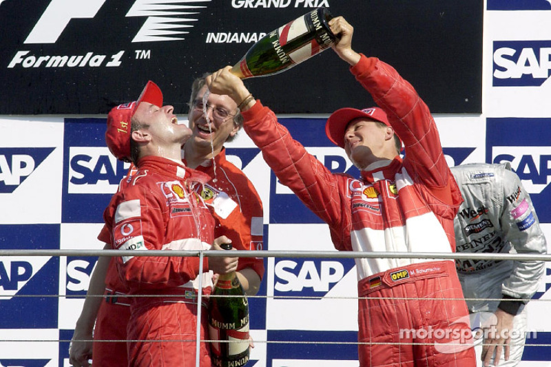 The podium: champagne for race winner Rubens Barrichello and Michael Schumacher