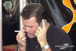 Robby Gordon wonders which cell service he is using