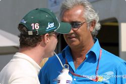 Eddie Irvine and Flavio Briatore