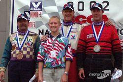 The podium: race winner John Fergus with Hans Peter and David Ferguson