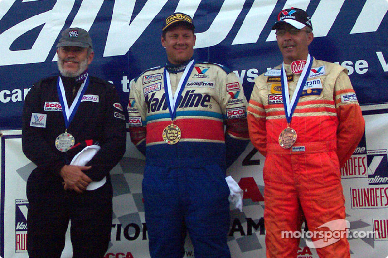 The podium: race winner Brad Stout with Gary Kittell and Andres Serrano