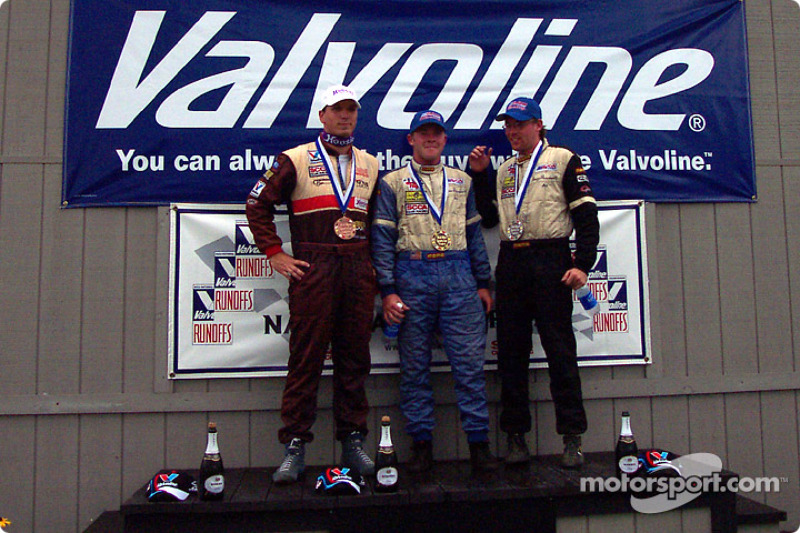 The podium: race winner Andrew Prendeville with Doug Prendeville and Brian Tomasi