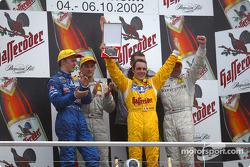 The podium: Mattias Ekström, race winner Bernd Schneider, DTM champion Laurent Aiello and Uwe Alzen