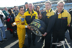 Laurent Aiello receives a signed tire from Dunlop