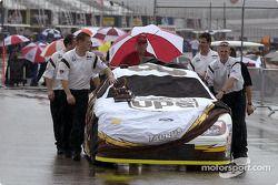 The Robert Yates crew push the UPS Ford Taurus through the rain