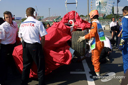 Allan McNish's wrecked Toyota back in the pits
