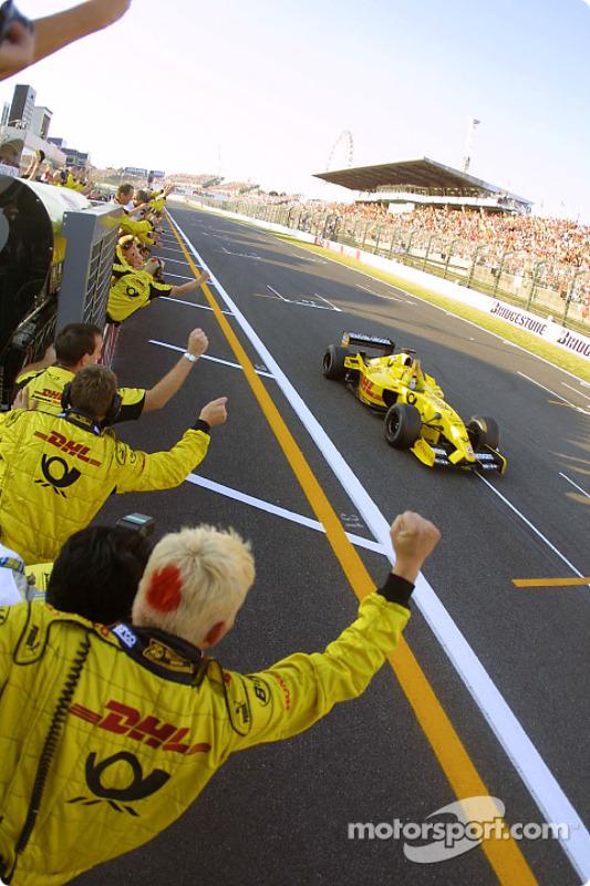 Takuma Sato celebrates his first points in Formula 1