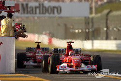 Michael Schumacher takes the checkered flag in front of Rubens Barrichello