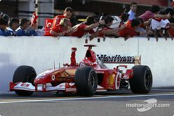 Michael Schumacher celebrates victory