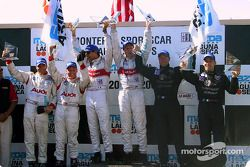The podium: overall and LMP 900 winners Emanuele Pirro and Frank Biela with Johnny Herbert, Stefan J