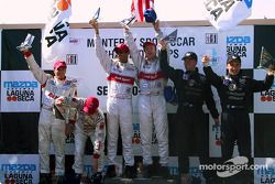 The podium: overall and LMP 900 winners Emanuele Pirro and Frank Biela with Johnny Herbert, Stefan Johansson, Max Angelelli and J.J. Lehto
