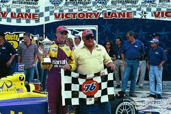 A.J. Foyt IV celebrates with A.J. Foyt and his team