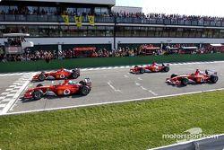 Four Ferrari F2002 on the track: Rubens Barrichello, Luca Badoer, Luciano Burti and Michael Schumacher