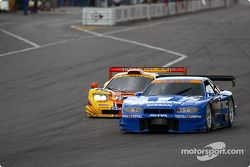 #76 Yellow Corn McLaren GT try to pass #12 Calsonic Skyline