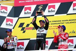 Alex Barros raises trophy