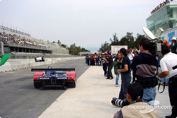 The Mexican media records the event as David Brabham leaves pit lane in an American Le Mans Series Panoz LMP-01 to take the first laps on Autodromo Hermanos Rodriguez