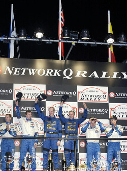 The podium: winners Petter Solberg and co-driver Phil Mills with Markko Martin and Carlos Sainz