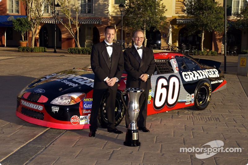 Champion Greg Biffle and car owner Jack Roush pose for photos prior to banquet ceremonies