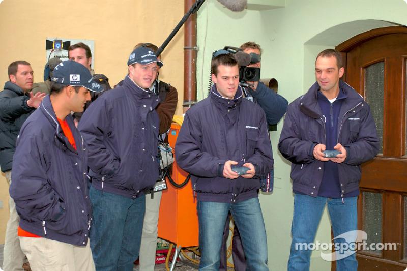 BMW Drivers Ralf Schumacher, Juan Pablo Montoya, Dirk Muller and Jorg Muller have ago at remote cont