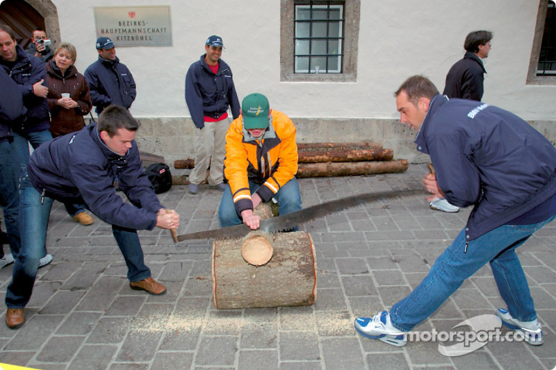 BMW Drivers Dirk Muller and Jorg Muller try their hand a sawing a log