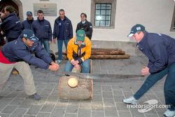 BMW Drivers Ralf Schumacher and Juan Pablo Montoya try their hand a sawing a log