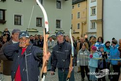 BMW Drivers Ralf Schumacher and Juan Pablo Montoya have a go at archery
