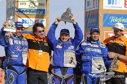 Winner Richard Sainct celebrates with Cyril Despres and Fabrizio Meoni