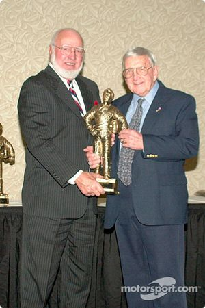 Dr. Joe Mattioli and Junie Donlavey display the award