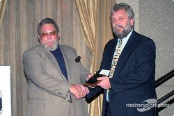 Rich Romer (EMPA Internet Director) presents the Internet News category award to Dave Reininger; Andy Belmont Motorsports sponsored the awards for all the Internet categories