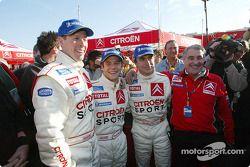 Rally winner Sébastien Loeb celebrates with Carlos Sainz, Colin McRae and Guy Fréquelin