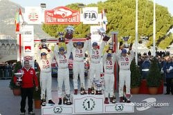 The podium: rally winners Sébastien Loeb and Daniel Elena with Carlos Sainz, Marc Marti, Colin McRae and Derek Ringer