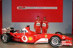 Michael Schumacher and Rubens Barrichello with the new Ferrari F2003-GA