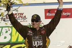 Race winner Dale Jarrett celebrates victory