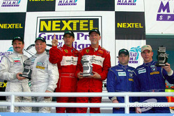 The podium: GT winners Cort Wagner and Brent Martini with Kevin Buckler, R.J. Valentine, Brian Cunningham and Hugh Plumb